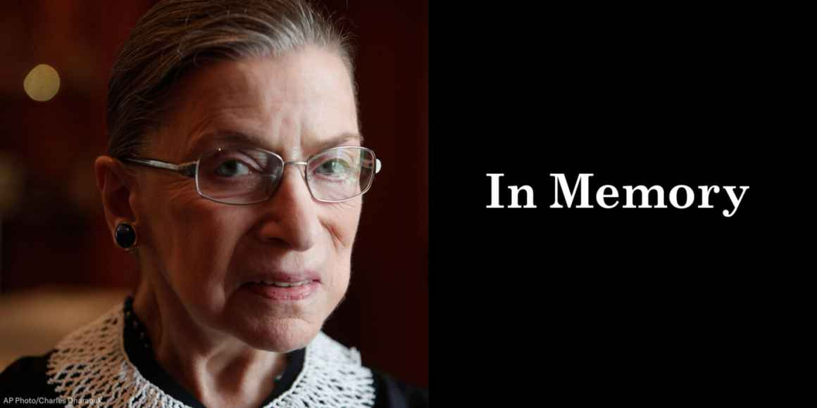 """A close up photo of Supreme Court Justice Ruth Bader Ginsburg is on the left. She is looking directly at the camera. On the right, a black box. In the box, """"in memory"""" is written in white letters."""