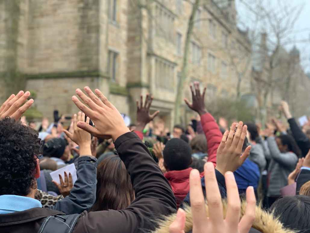 "Protesters in New Haven stand in ""hands up don't shoot"" position protesting Hamden and Yale police shooting of Stephanie Washington and Paul Witherspoon"