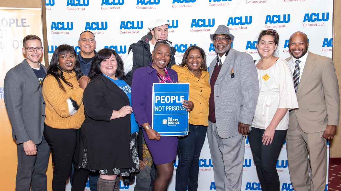 "ACLU-CT Smart Justice leaders and Rep. Robyn Porter stand in front of an ACLU of Connecticut banner at the ""Smart Justice: Year One"" film premiere in New Haven"