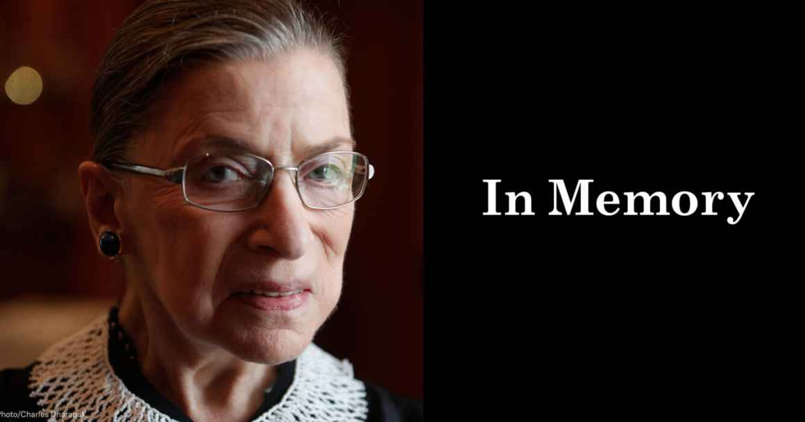 "A close up photo of Supreme Court Justice Ruth Bader Ginsburg is on the left. She is looking directly at the camera. On the right, a black box. In the box, ""in memory"" is written in white letters."